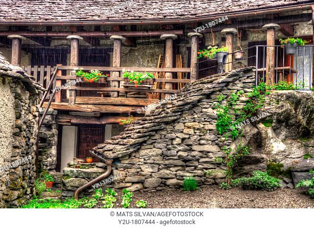 Rustic house in stone with balcony