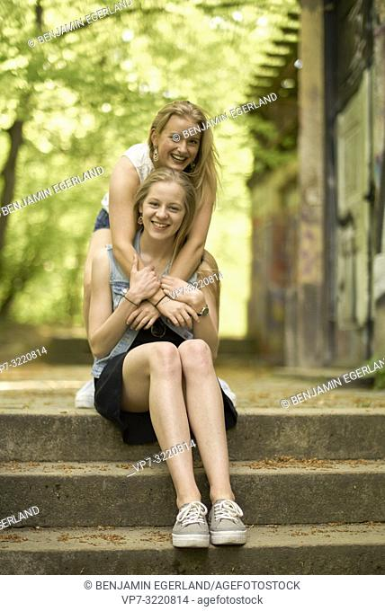 two women, best friends, embracing, in Munich, Germany