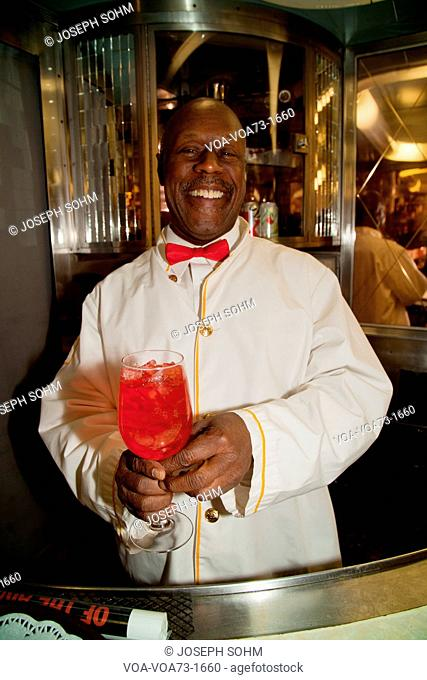 African American Porter reenactor pours cherry soda on Pearl Harbor Day Troop train reenactment from Los Angeles Union Station to San Diego