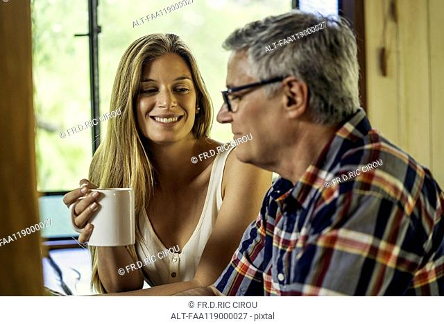 Woman talking with her father