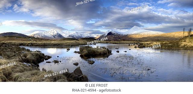 Panoramic view across Lochain Na h'Achlaise on clear winter morning towards the snow-covered mountains of the Black Mount range, Rannoch Moor, near Fort William