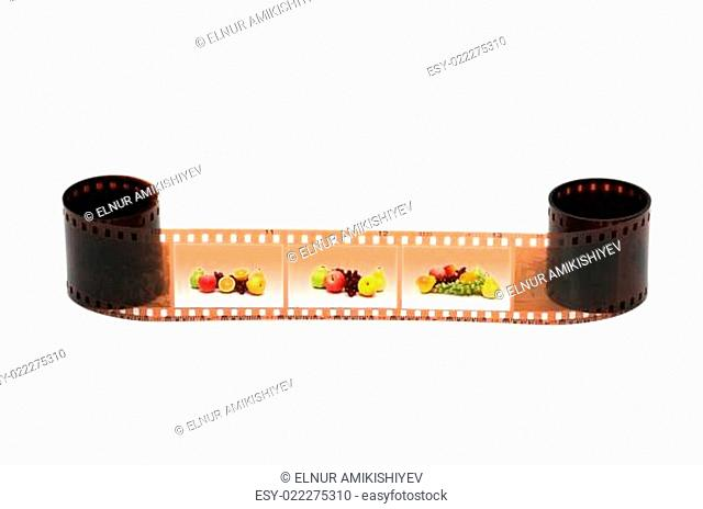 Roll of film with fruits images on white