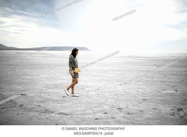 South Africa, Western Cape, Noordhoek, woman walking on the beach
