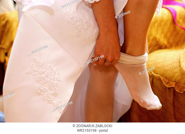 Bride shoes. Leg of young woman in shoes