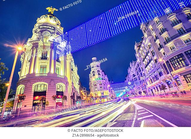 Grassy building and Gran Via street at Christmastime. Madrid. Spain