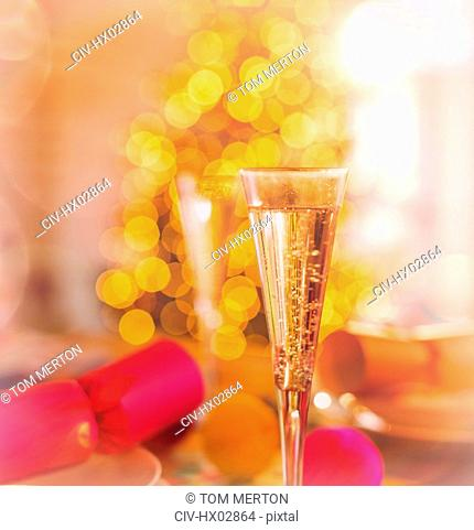 Close up champagne flutes and Christmas crackers