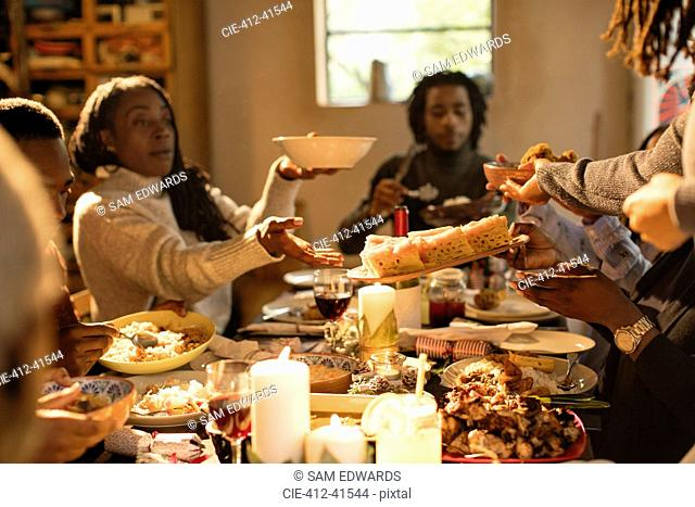 Family passing food at Christmas dinner