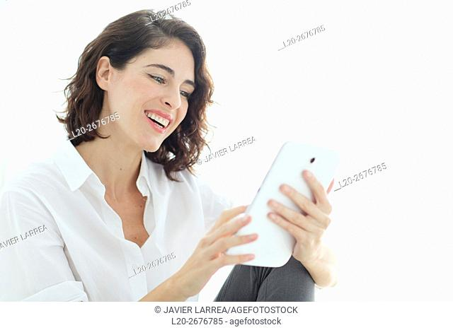 Woman using tablet computer and smiling