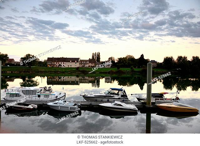 Tournus on the banks of the river Saone with reflection, Saon-et-Loire, Burgundy, France