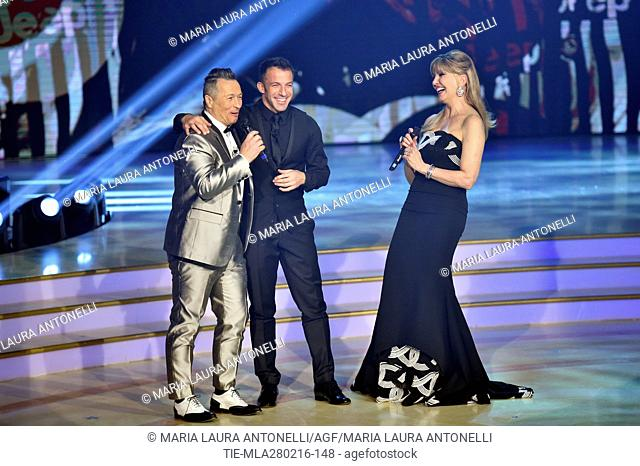 Paolo Belli with jersey of former football player Alessandro Del Piero and Milly Carlucci during the talent show Dancing with the stars, Rome, ITALY-27/02/2016