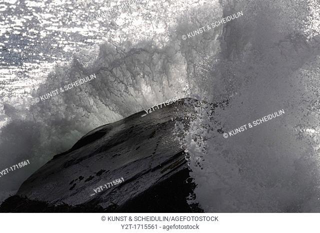 Wave breaking on a large rock. North Atlantic, Unstad, Vestvågøy, Lofoten, Nordland, Norway, Scandinavia, Europe