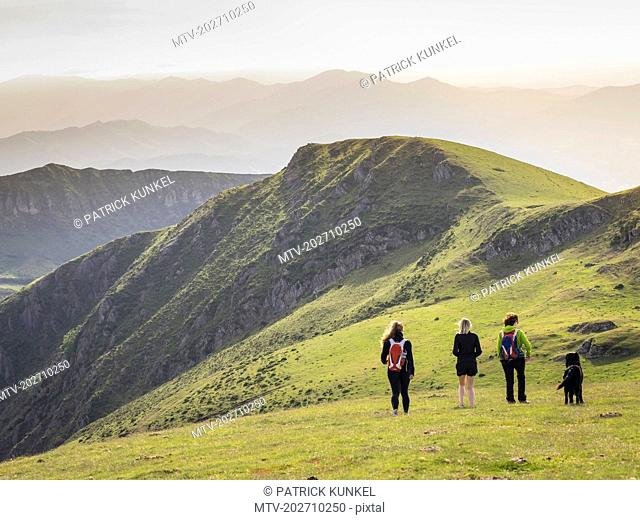 Three women with dog on a hiking tour to Mount Ganekogorta