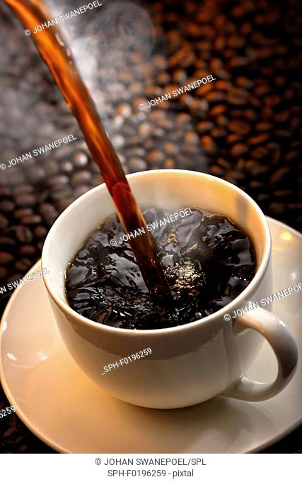 Fresh coffee being poured into cup