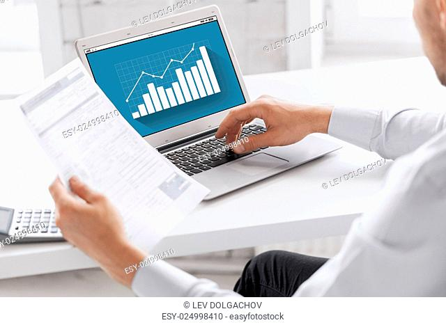 business, technology, statistics and people concept - close up of businessman with graph on laptop computer screen working at office