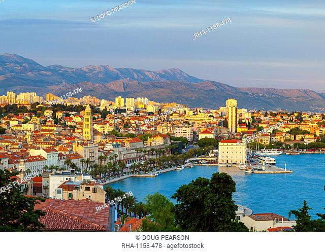 Elevated view over Split's picturesque Stari Grad and harbour illuminated at sunset, Split, Dalmatia, Croatia, Europe