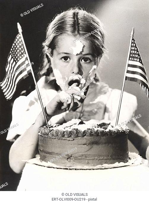 Girl with July 4th cake all over her face