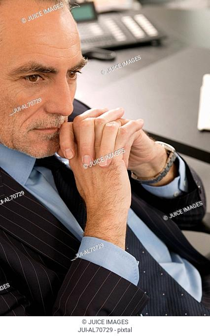 Mature businessman deep in thought