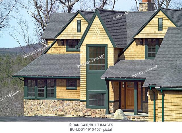 Exterior shingle style home with green accents