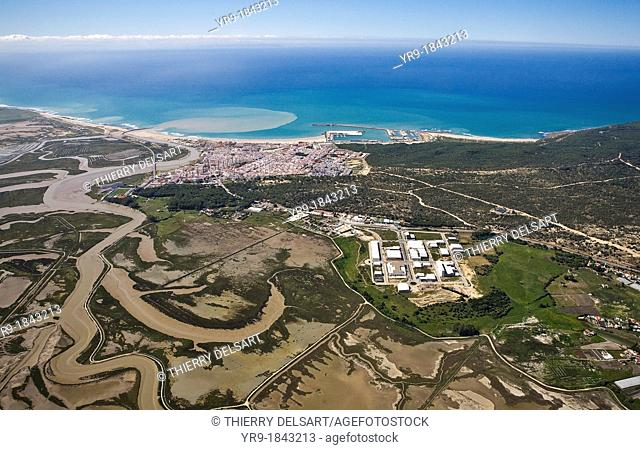 Barbate de Franco Cádiz, Spain Aerial view  The city and its little harbour  The river mouth throw browny water into the sea  Salt lakes on the left  Tanger...
