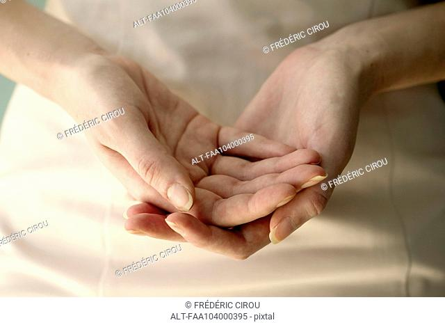 Woman's cupped hands, close-up
