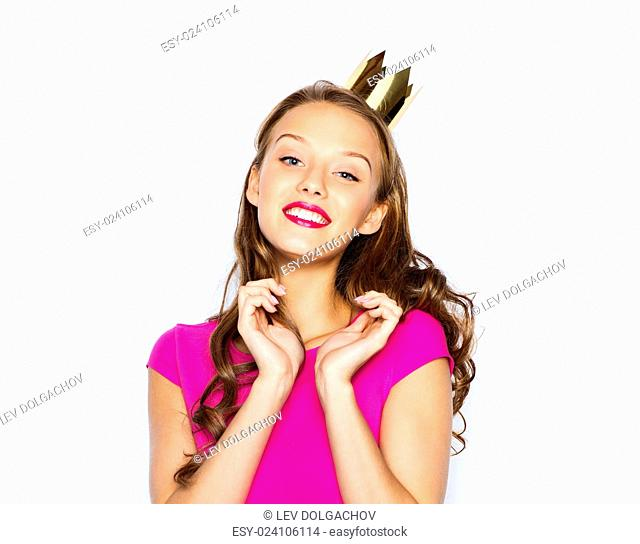 people, holidays and fashion concept - happy young woman or teen girl in pink dress and princess crown