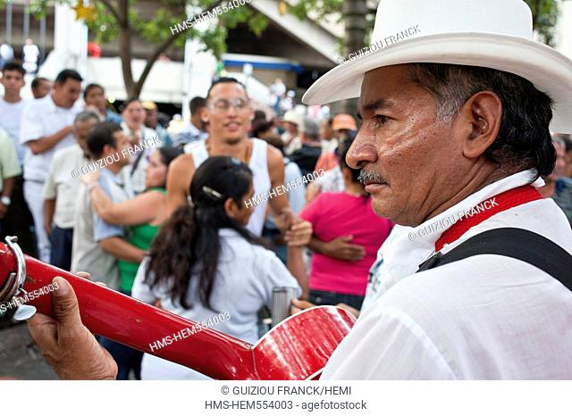 Colombia, Antioquia Department, Medellin, downtown, Villanueva District, dance in the Parque Berrio on Sunday afternoon