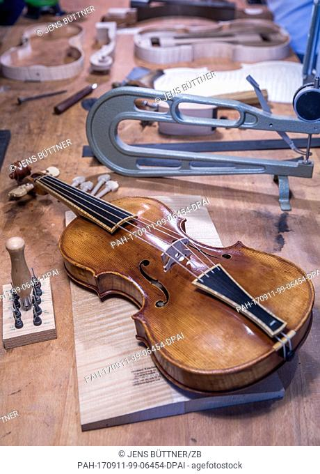 The replica of a violine made by Andrea Amati from Cremona is lying in Ritschard's workshop in his workshop in Herrnburg, Germany, 07 September 2017