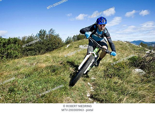 mountain biker on the way downhill, Vipava valley, Istria, Slovenia
