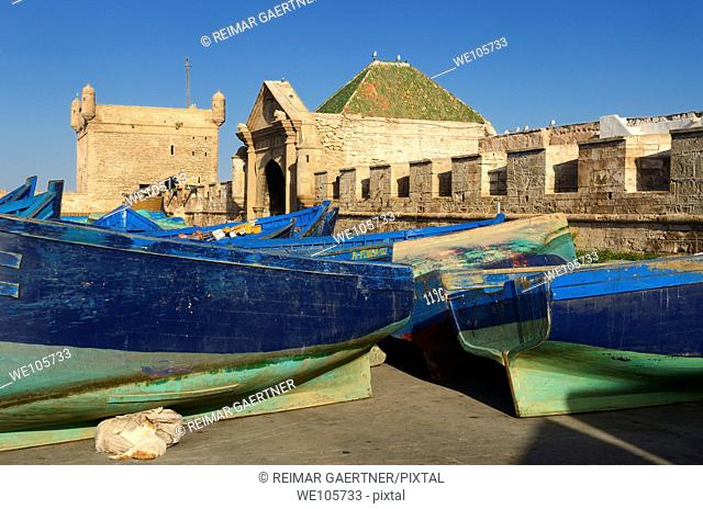 Sqala du Port and Marine Gate with blue and green fishing boats for sale in Essaouira Morocco