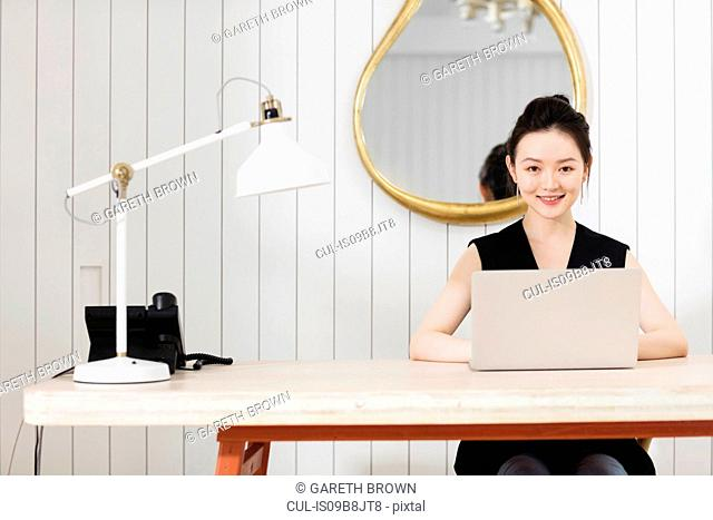 Woman at desk with laptop