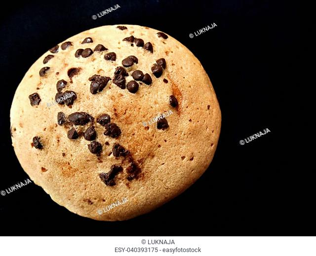 Bread with chocolate chip on black background