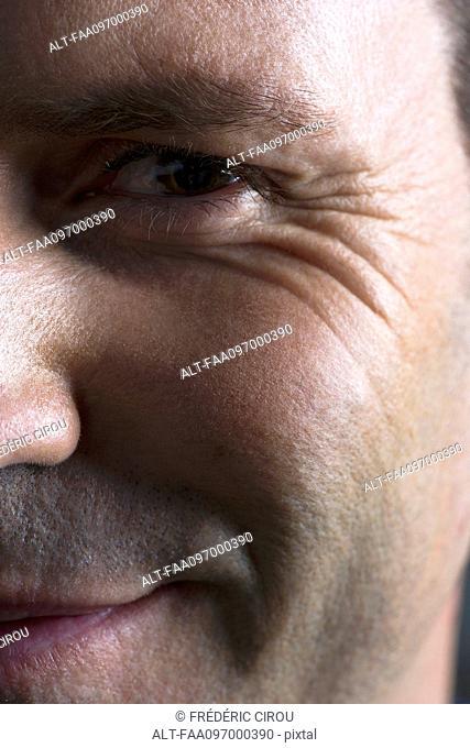 Man's face, smiling, close-up