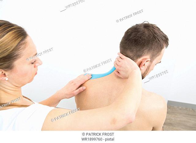 Man getting kinesiology tape