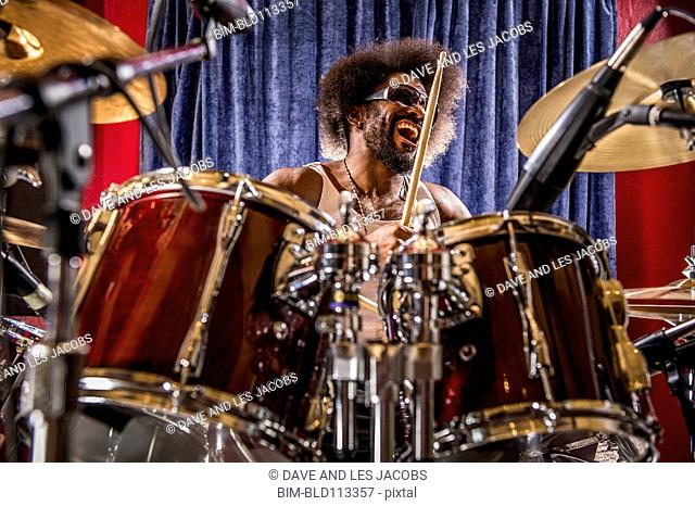 Mixed race drummer performing