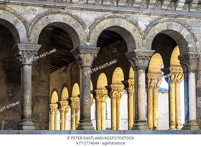 The Romanesque, arcaded portico of San Martin church, in the Plaza Medina del Campo, Segovia, Spain
