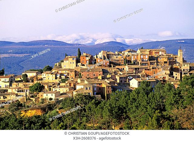 Roussillon, one of The most beautiful villages of France, with the Mont Ventoux in the background, Luberon Massif, Vaucluse department