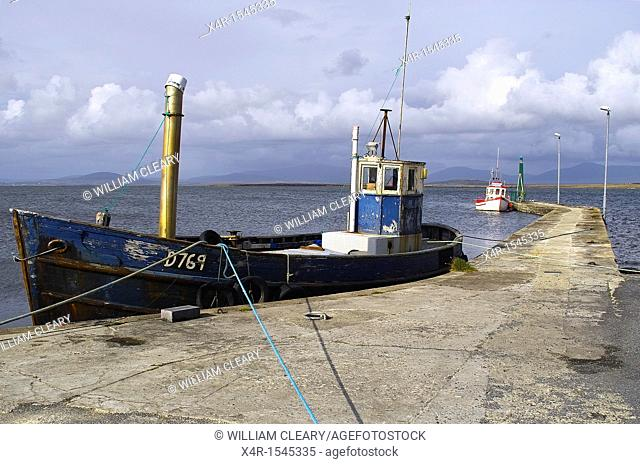 Moored fishing boats at a small pier on Achill Island, County Mayo, Ireland