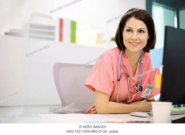 Female nurse sitting at desk