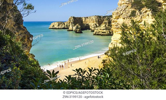 tourists at praia da marinha in pre-season, praia da marinha, high-angle view, caramujeira, algarve, portugal