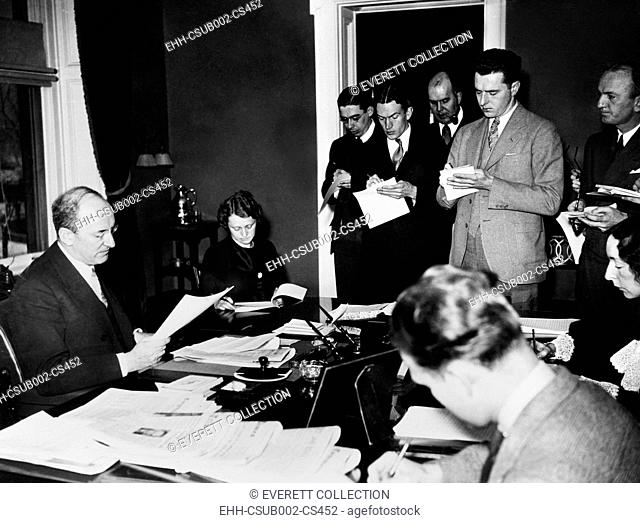 Secretary of the Treasury Henry Morgenthau, Jr. speaking the reporters, Jan. 17, 1935. He announced the Treasury Department was putting 1000 men to work in...