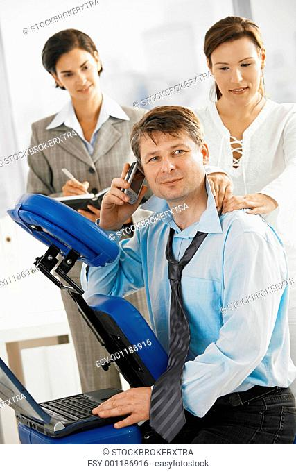 Executive getting massage in office