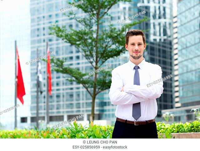 Young businessman standing at outdoor in Hong Kong