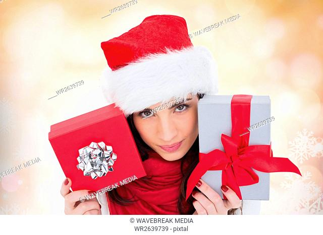 Beautiful woman in santa hat holding gifts