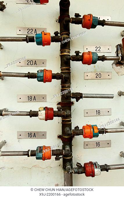 Gas meters on a house wall, Georgetown, Penang, Malaysia