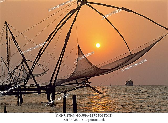Chinese fishing nets at Kochi at sunset, State of Kerala, India, South Asia