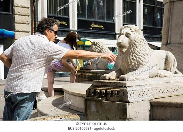 Lion fountain in central Pest