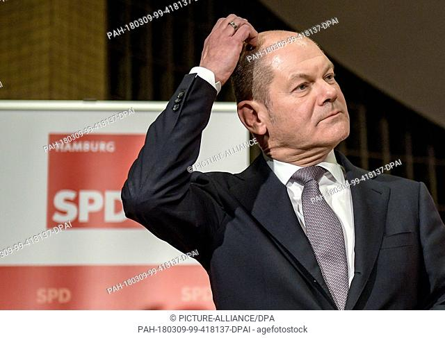 09 March 2018, Germany, Hamburg: Olaf Scholz, departing mayor of Hamburg, scratching his head during a press statement in the Kurt-Schumacher-Haus