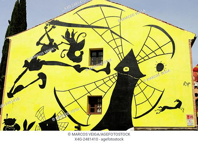 Don Quixote and the windmill. An outdoor graffiti in Alcala de Henares, Madrid