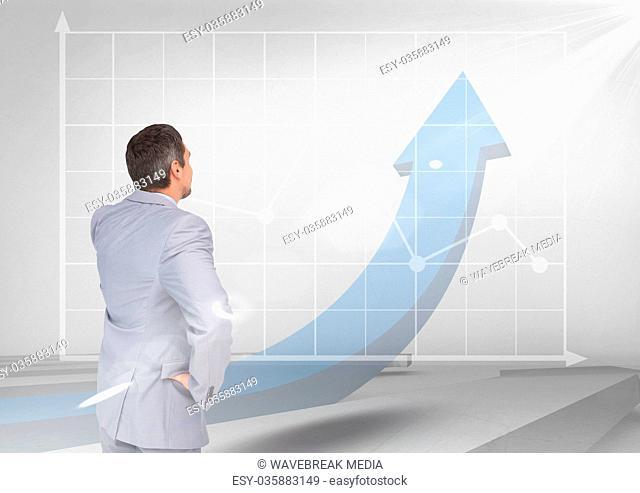 businessman on blue arrow and graph
