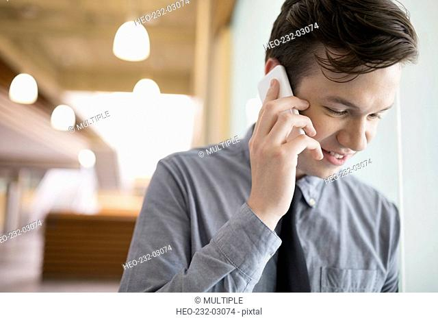Close up brunette businessman talking on cell phone
